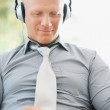 Royalty-Free Stock Photo: Successful business man enjoying music on an mp3 player