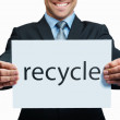 Royalty-Free Stock Photo: Mid section of a business man with a recycle sign on white