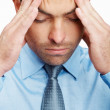 Stressed business man with a headache - Foto de Stock