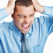 Royalty-Free Stock Photo: Frustrated business man yelling out loud because of a headache