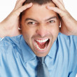 Royalty-Free Stock Photo: Headache - Portrait of an angry business man screaming in pain