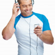Royalty-Free Stock Photo: Happy handsome guy listening to songs on the mp3 player