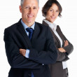 Royalty-Free Stock Photo: Business man with hands folded and colleague at the back