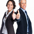 Royalty-Free Stock Photo: Successful business colleagues showing a success sign on white