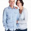 Beautiful smiling couple standing over white background - Stock Photo