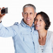 Royalty-Free Stock Photo: Smiling couple posing for a self portrait