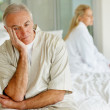 Couple having relationship issues , sitting in the bedroom - Stock Photo