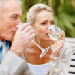 Royalty-Free Stock Photo: Happy relaxed couple drinking wine outdoors