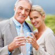Royalty-Free Stock Photo: Beautiful couple celebrating together with champagne
