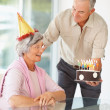 Royalty-Free Stock Photo: Happy senior  couple celebrating  with a birthday cake