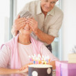 Royalty-Free Stock Photo: Birthday surprise - Senior man surprising his wife