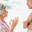 An old couple having a disagreement about something - Stock Photo
