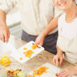 Royalty-Free Stock Photo: Smiling mature couple preparing food in the  kitchen