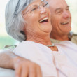 Royalty-Free Stock Photo: Happy retired old couple laughing out loud
