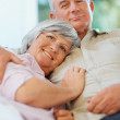 Royalty-Free Stock Photo: Closeup of a loving happy senior couple relaxing together