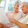 Royalty-Free Stock Photo: Senior man and woman reading documents at their house