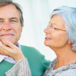Closeup of a elderly woman trying to cheer up a man - Stock Photo