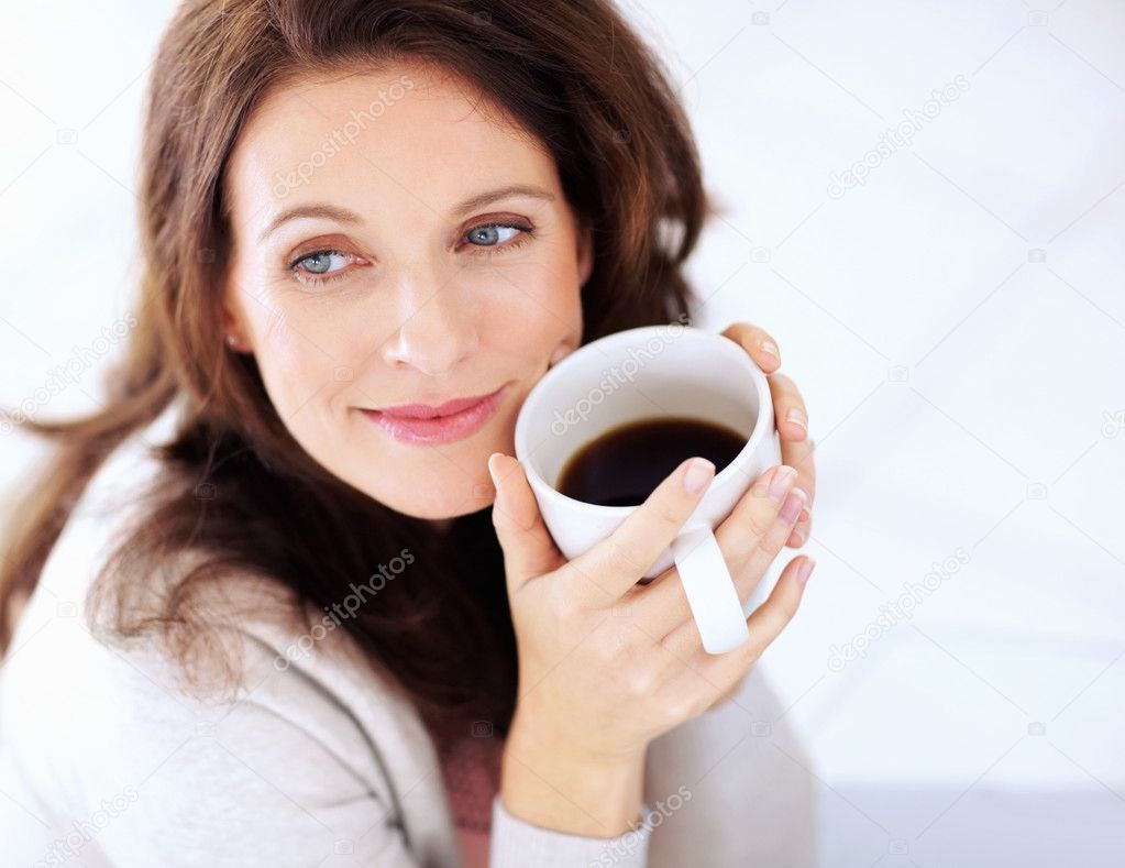Happy beautiful middle aged woman having coffee contemplating — Stock Photo #3354706