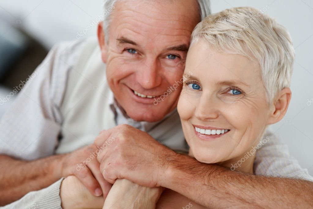 Closeup portrait of a senior hugging wife from the behind — Stock Photo #3355118