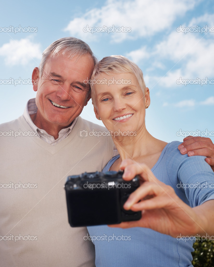 depositphotos 3355635 Self portrait photography  Happy older couple smiling Self portrait photography   Happy older couple smiling below cloudy sky