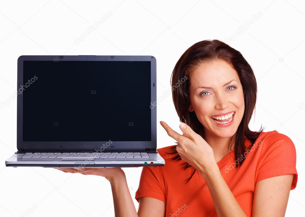 Happy woman with laptop pointing to blank screen where you can write your text — Stock Photo #3356071