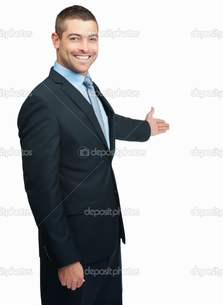 Businessman with arm out in a welcoming gesture , isolated on white background — Stockfoto #3357689