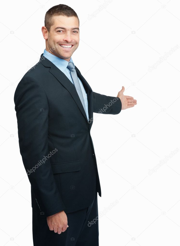 Businessman with arm out in a welcoming gesture , isolated on white background — Foto de Stock   #3357689