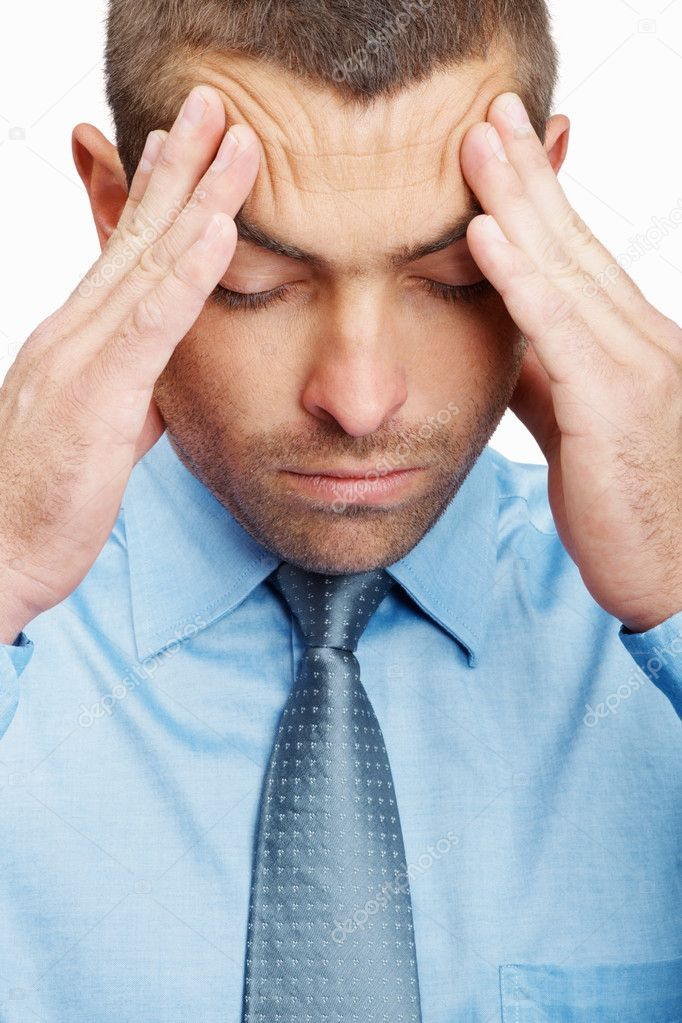 Closeup of a worried young business man holding head in pain , suffering from headache — Stock Photo #3357834