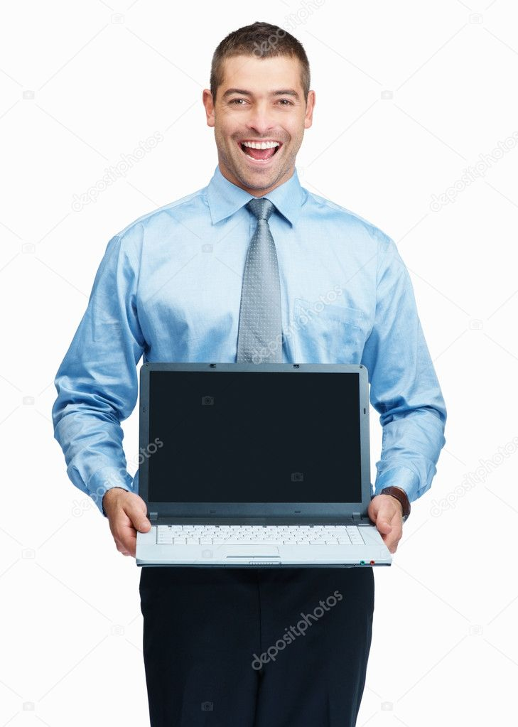 Business man with a big smile presenting a modern laptop isolated on white background — Stock Photo #3357944