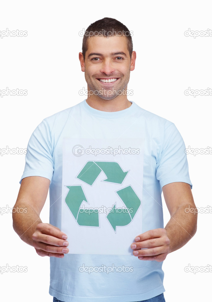 Smiling young man holding recycling sign to promote a green global awareness  Stock Photo #3358113