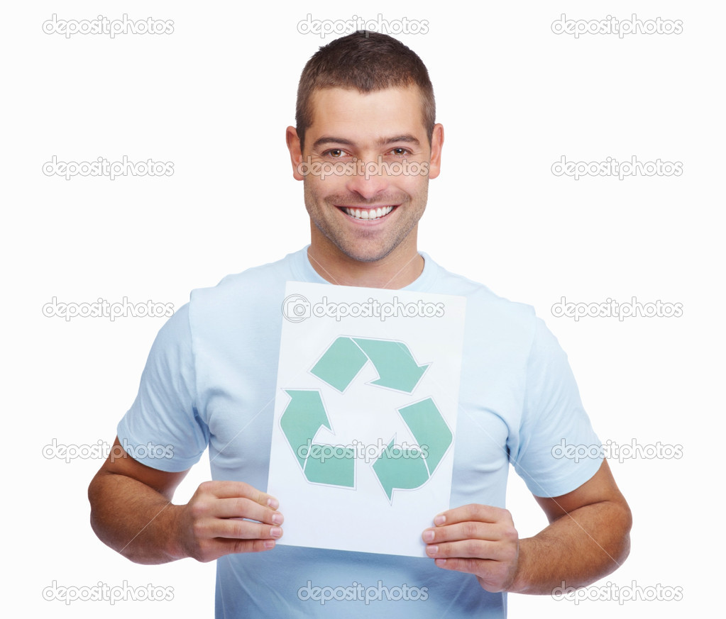 Young man promoting eco friendly practices , holding a recyclable symbol on white — Photo #3358116