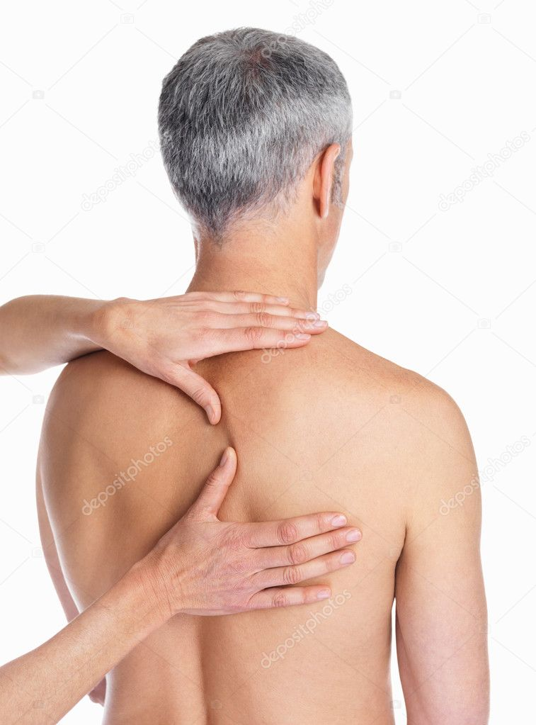 Woman's hand massaging males back on a white background — Stock Photo #3358734