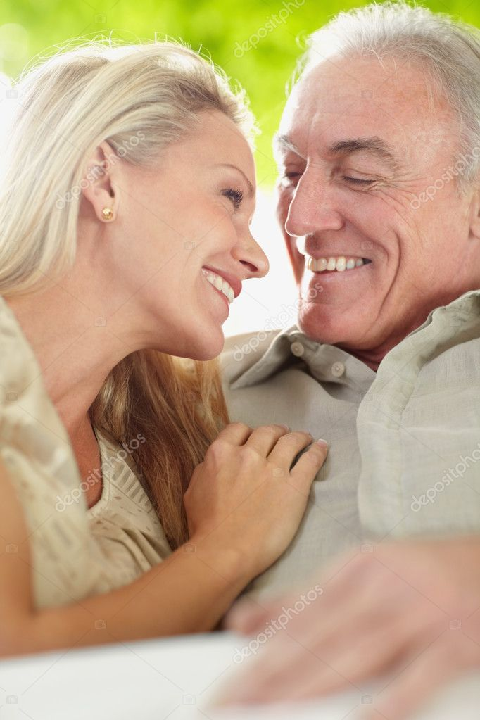 Closeup portrait of a mature romantic couple sitting together at home — Stock Photo #3358867