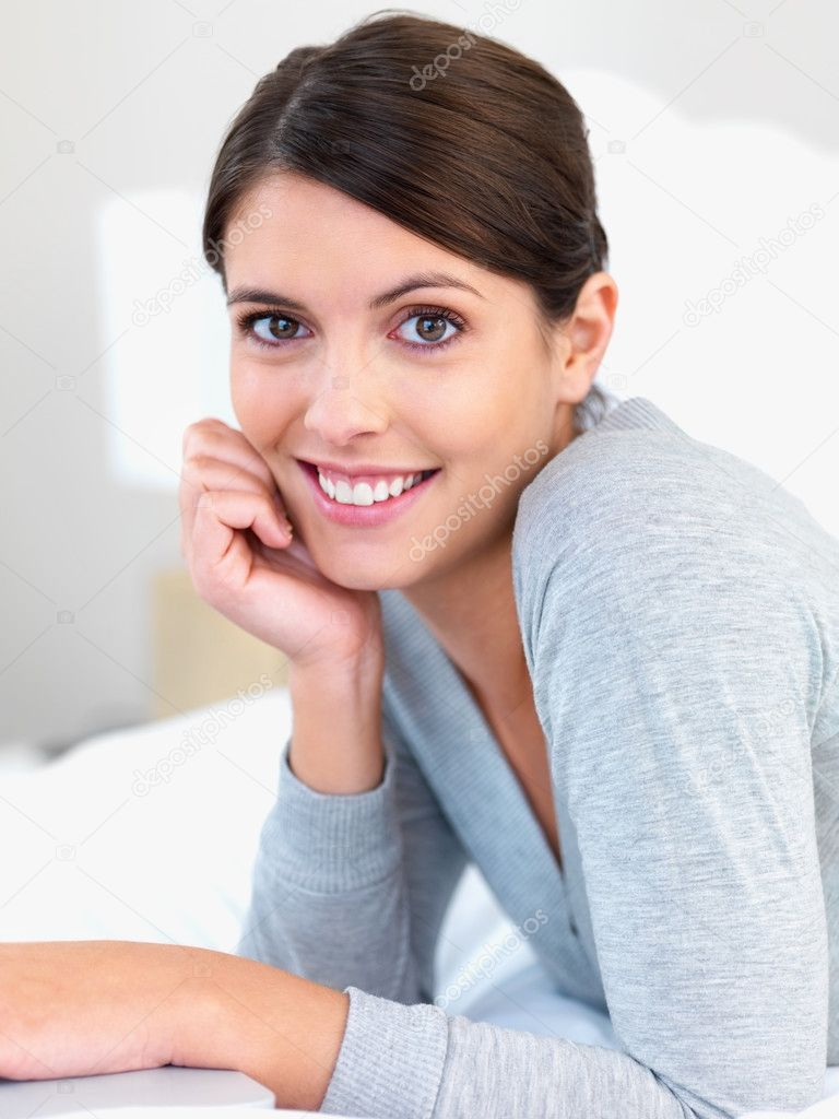 Closeup portrait of a sweet young female smiling in bed  Stock Photo #3359834