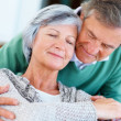 Closeup of a cute romantic senior couple with eyes closed - Stock Photo