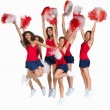 Team of cheerleaders jumping of joy on white - Stock Photo