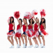 Royalty-Free Stock Photo: Smiling female cheerleaders posing against white