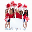 Smiling cheerleaders holding a blank billboard for your text - Foto Stock