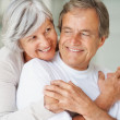 Cute elderly couple hugging each other - Foto Stock