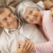 Senior man and woman spending romantic time together - Stock Photo