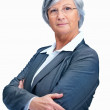 Elderly female executive with arms folded isolated over white - Stock Photo