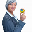 Royalty-Free Stock Photo: Portrait of a mature business woman holding a  Cube