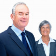 Royalty-Free Stock Photo: Cheerful business man with smiling business woman at the back