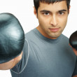 Royalty-Free Stock Photo: Handsome young boxer with boxing gloves against white