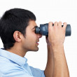 Profile view of a man searching for something with binoculars - Stock Photo