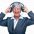 Royalty-Free Stock Photo: Elderly woman with headphones playing very loud music