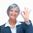 Royalty-Free Stock Photo: Happy elderly business woman showing a positive gesture