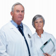 Royalty-Free Stock Photo: Doctor and a nurse against white background