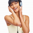 Royalty-Free Stock Photo: Cute female listening to music over headphones