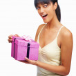 Royalty-Free Stock Photo: Pretty young female with a birthday present isolated on white